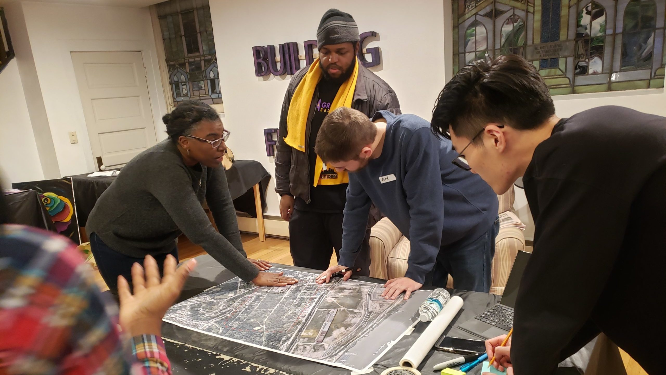 Students look at architectural plans