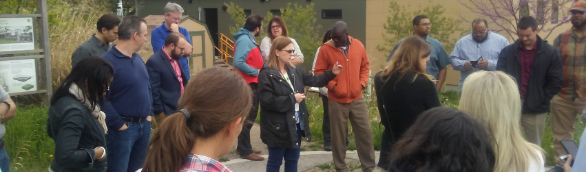 Instructor discussing urban research opportunities with a group outside